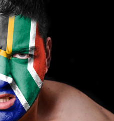 Portrait of angry man with painted flag of South Africa