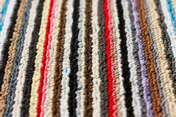 Carpet in multicolored stripes vertical close-up
