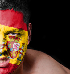 Portrait of angry man with painted flag of Spain
