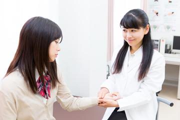 two asian women in clinic