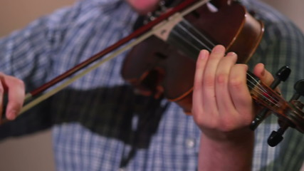Male plays violin performing at classical concert, music event