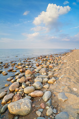 Stones at the ocean beach. The Baltic Sea coast, Poland.