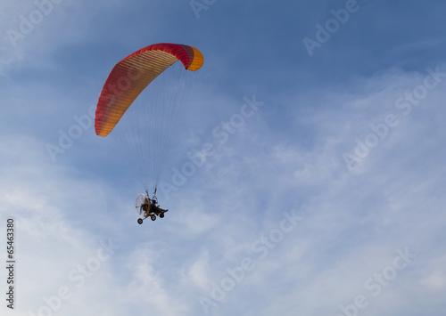 Fototapeta Paramotor flying in the sky