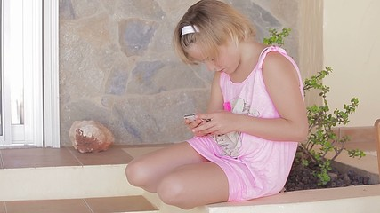Child girl playing game on tablet (three shots sequence))