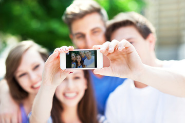 Friends taking a selfie with smartphone