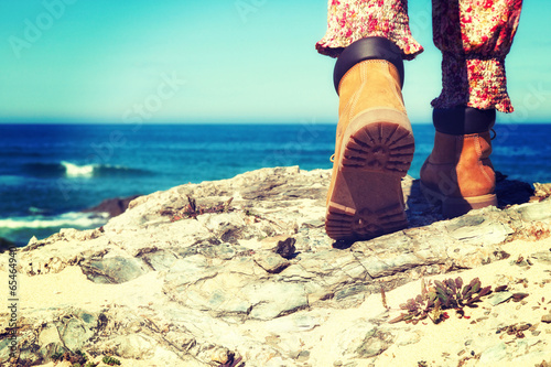hiking boots on rocks