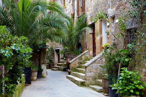 Narrow Alley With Old Buildings In Italian City - 65465186