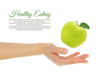 Female hand with fresh green apple isolated on white