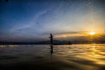 throwing fishing at sunset