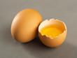 Broken egg isolated on gray background