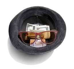 dollars in a black hat with sunglasses