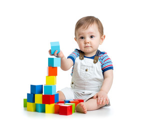 baby toddler playing with building block toys