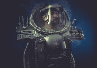 robot man in space armor silver