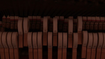 Piano hammers hitting strings