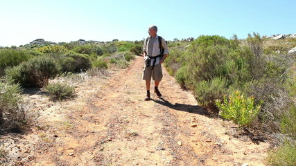 Man hiking in nature on wild trail