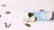 Euro coins and notes falling