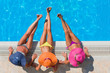Girls  relaxing in a swimming pool