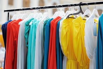 A few beautiful dresses on a hanger