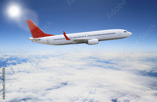 Plane flying over the clouds Poster