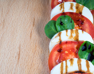 Simple snack canape with tomato, mozzarella and basil