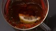 Lemon slice falling in cup of tea