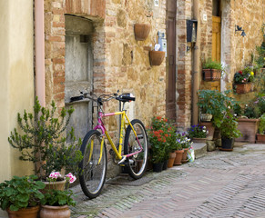 Bicycle stands on the street in the town of Pienza