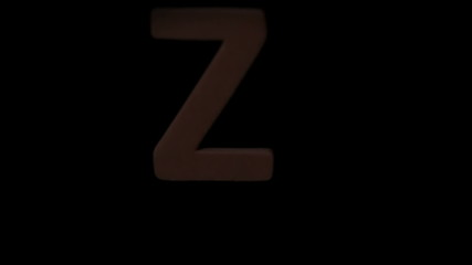 The letter z rising on black background