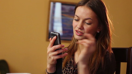 Attractive young woman typing message to boyfriend relationships