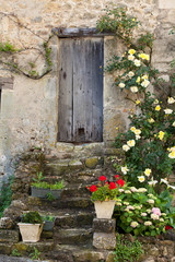 cottage with roses around door