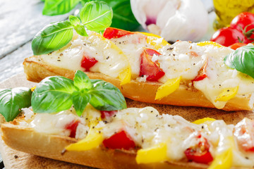 Bruschetta with tomatoes and bell peppers mozzarella