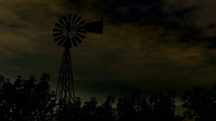 Windmill Silhouette with lightning In Storm Clouds