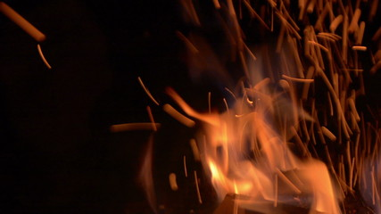 Fire and sparks at night close up tracking shot