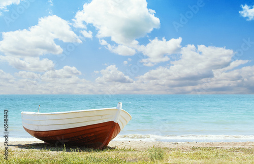 Red Boat on the Beach - 65484143