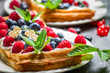 Waffels with cream, blueberry and raspberry