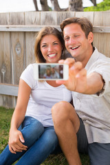 Couple taking selfie with phone