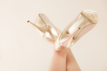 Closeup of female feet in golden high heels