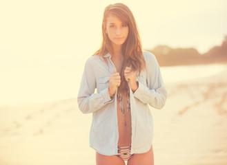 Fashion lifestyle, Beautiful woman on the beach at sunset.