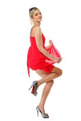 Beautiful blonde girl in red summer dress