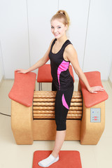 Girl using relax massage equipment healthy spa salon