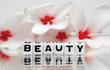 Beauty text with red flowers