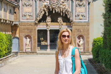 Attractive girl near the grotto Buontalenti in the Boboli garden