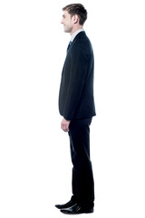 Young executive posing in business suit