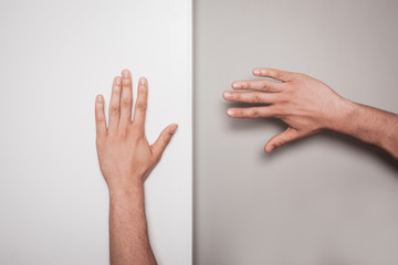 Two hands against a green and white background