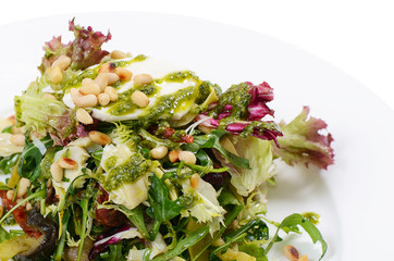 Salad with rucola and pine nuts
