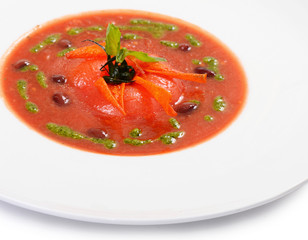 Soup from baked tomatoes with pesto
