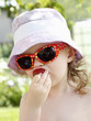 Little child eating strawberry in the summer
