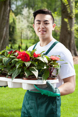Asian gardener with plants