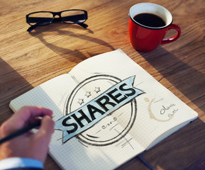 Businessman's table with Shares Concept