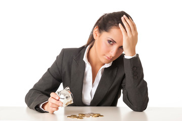 Worried businesswoman counting coins against white background.