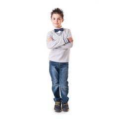 Full body portrait of eight year kid with crossed arms wearing p